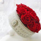 букет невесты из красных рох
